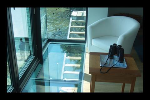 The glazed bay to the master bedroom comes with a glass floor looking  down to the water directly below